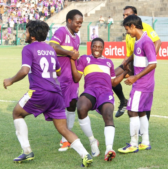 Ranti Martins (centre) celebrates with team-mates