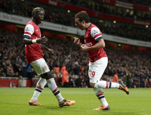 Arsenal's Santi Cazorla (R) with team-mate Bacary Sagna celebrates after scoring a goal