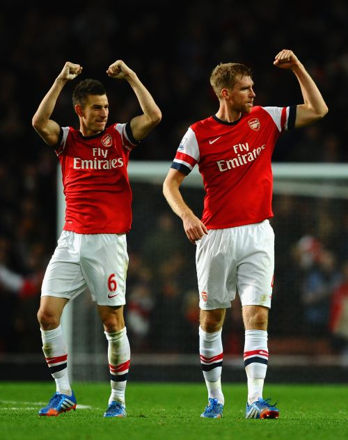 Laurent Koscielny of Arsenal and Per Mertesacker of Arsenal celebrate victory