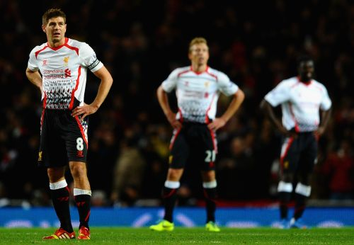 A dejected Steven Gerrard of Liverpool looks to the big screen after they conceded a second goal