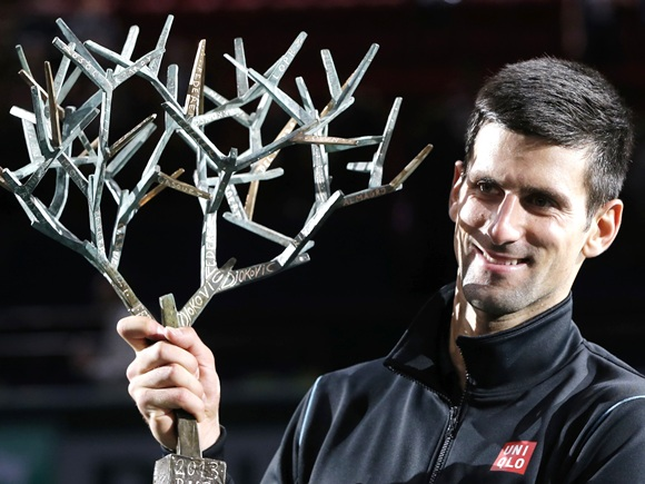 Novak Djokovic of Serbia holds his trophy