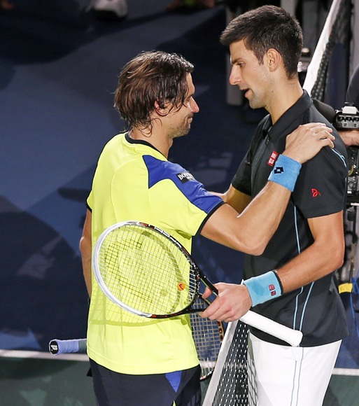 David Ferrer of Spain (left) congratulates Novak Djokovic of Serbia