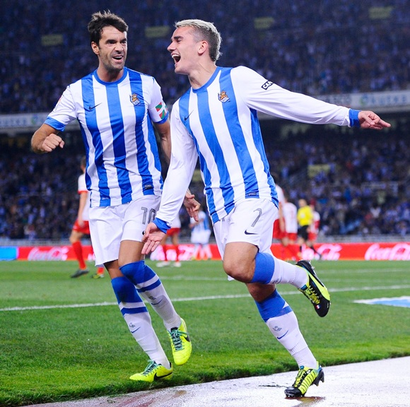 Antoine Griezmann (right) of Real Sociedad de Futbol celebrates with his teammate Xabier Prieto Argarate