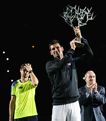 Novak Djokovic of Serbia with the winners trophy after defeating David Ferrer of Spain in the final of the Paria Masters on Sunday