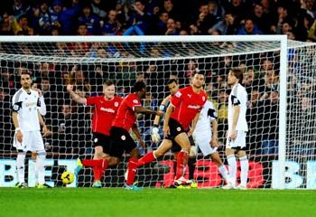 Steven Caulker of Cardiff City (2R) celebrates scoring