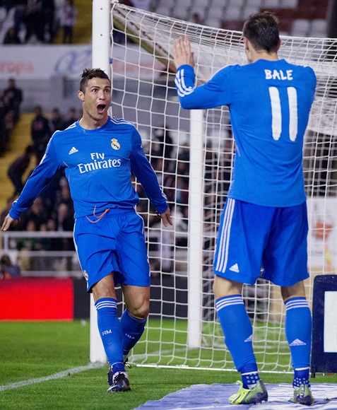 Cristiano Ronaldo of Real Madrid celebrates scoring his team's third goal with teammate Gareth Bale