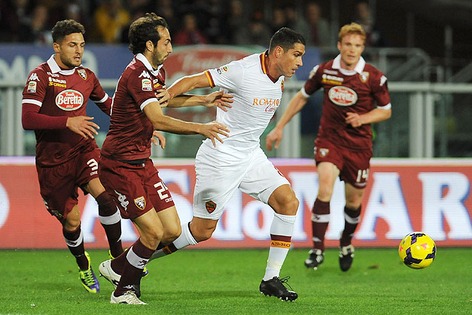 Emiliano Moretti of Torino FC competes with Marco Borriello (right) of AS Roma during their Serie A match at Stadio Olimpico di Torino in Turin on Sunday