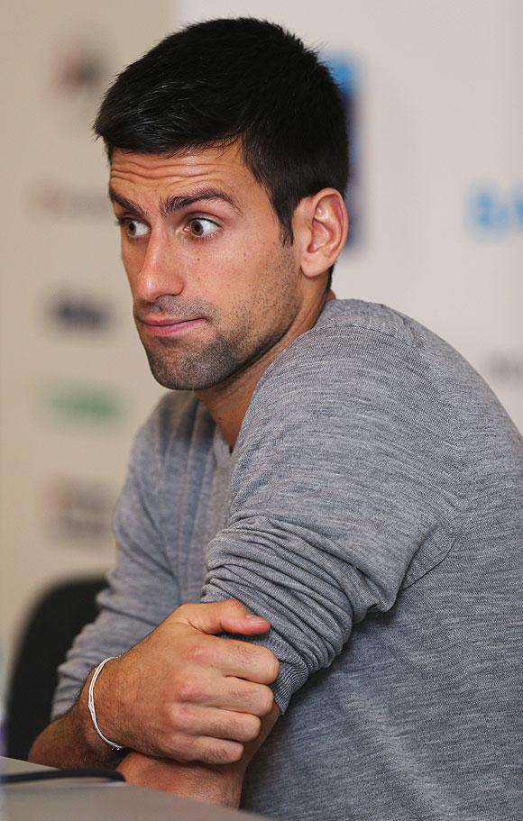 Novak Djokovic of Serbia talks to the media on Day 1 of the ATP World Tour Finals at O2 Arena in London on Monday