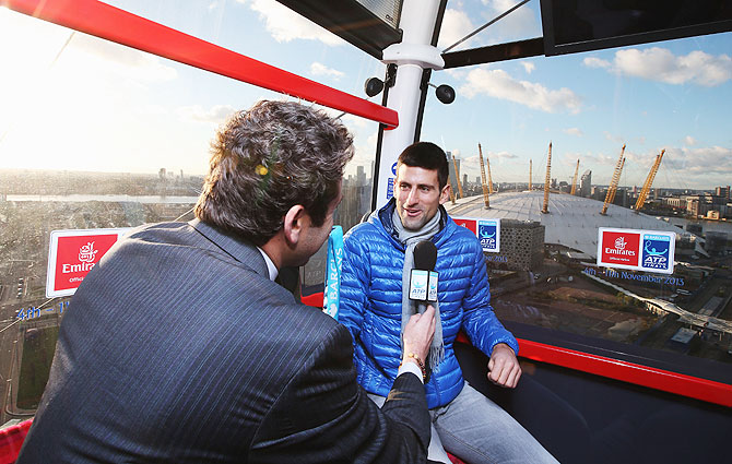 Novak Djokovic of Serbia travels to the O2 Arena by cable car on Day 1 of the Barclays ATP World Tour Finals at O2 Arena in London on Monday