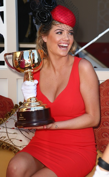 Kate Upton poses with the Melbourne Cup