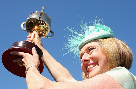 Gai Waterhouse the trainer of Fiorente holds up the Melbourne Cup after winning race 7 the Emirates Melbourne Cup