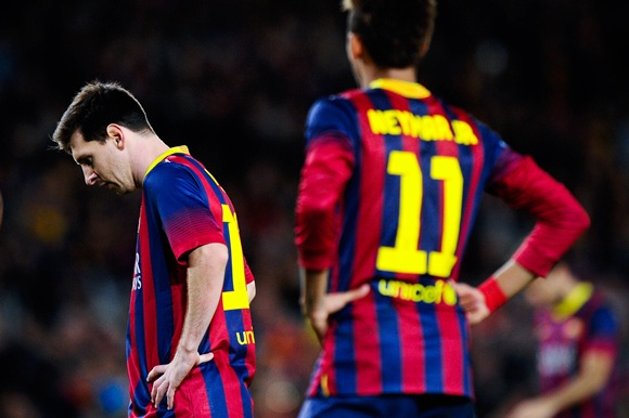 Lionel Messi of FC Barcelona looks down beside his teammate Neymar
