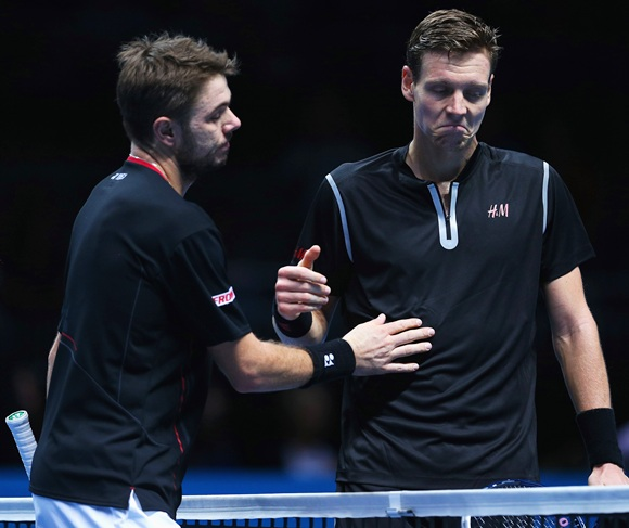 Stanislas Wawrinka (left) of Switzerland consoles Tomas Berdych of the Czech Republic