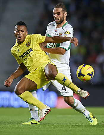 David Lomban (right) of Elche is challenged by Ikechukwu Uche of Villarreal during their La Liga match at Estadio Manuel Martinez Valero in Elche on Monday