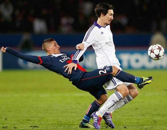 Marco Verratti of PSG (left) tackles Sacha Kljestan of Anderlect