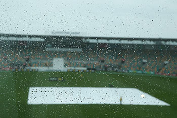 A general view is seen of rain drops on a window as rain delays the start of play during day two of the tour match between Australia A and England at the Bellerive Oval in Hobart on Thursday