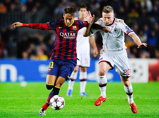 Neymar of FC Barcelona duels for the ball with Ignazio Abate of AC Milan during their UEFA Champions League Group H match at Camp Nou in Barcelona on Wednesday