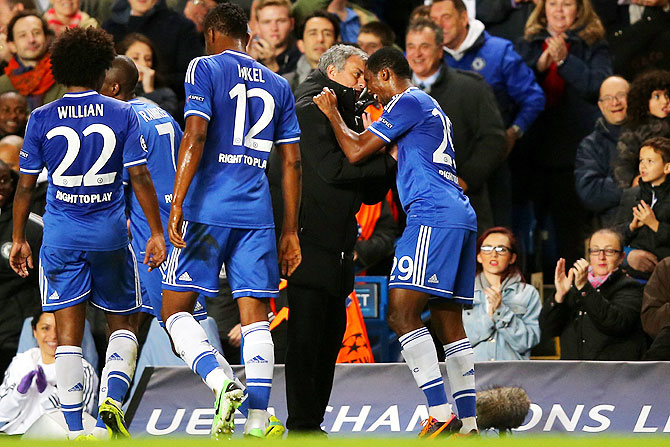 Samuel Eto'o of Chelsea celebrates with team manager Jose Mourinho after scoring the opening goal of their UEFA Champions League Group E match against FC Schalke 04 at Stamford Bridge in London on Wednesday