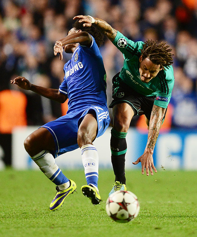 Willian of Chelsea and Jermaine Jones of Schalke collide during the UEFA Champions League Group E match at Stamford Bridge in London on Wednesday