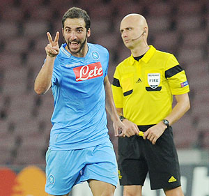 Gonzalo Higuain of Napoli celebrates after scoring their third goal during the UEFA Champions League Group F match against Olympique Marseille at Stadio San Paolo in Naples on Wednesday
