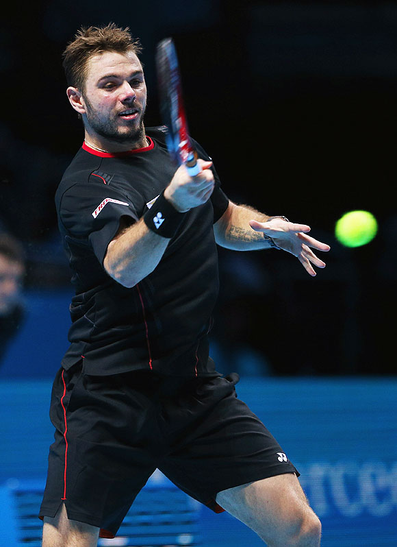 Stanislas Wawrinka  of Switzerland hits a forehand during his men's singles match against Rafael Nadal of Spain during their ATP World Tour Finals match at O2 Arena in London on Wednesday