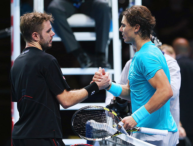 Rafael Nadal (right) of Spain is congratulated by Stanislas Wawrinka of Switzerland after their men's singles match in the ATP World Tour Finals match at O2 Arena in London on Wednesday