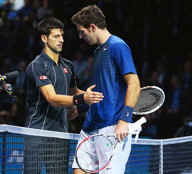 Novak Djokovic of Serbia consoles Juan Martin Del Potro of Argentina after his victory in their men's singles match of the ATP World Tour Finals at O2 Arena in London on Thursday