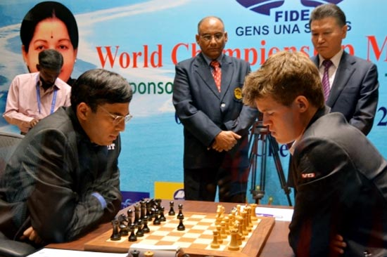 Viswanathan Anand (left) in action against Magnus Carlsen