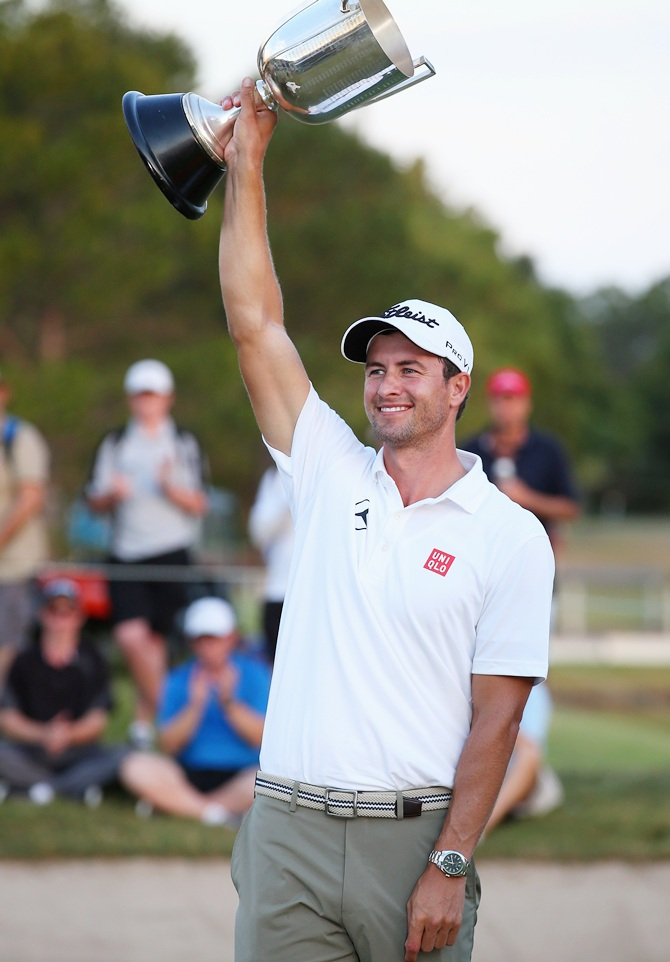 Adam Scott of Australia holds the kirkwood cup