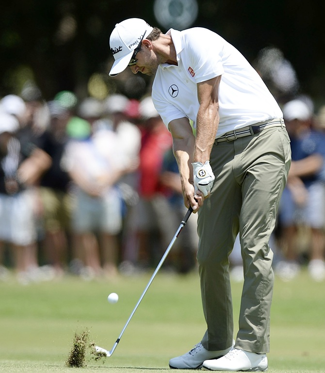 Adam Scott of Australia plays a shot