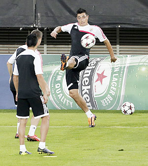 Benfica's Oscar Cardozo kicks the ball during a training session