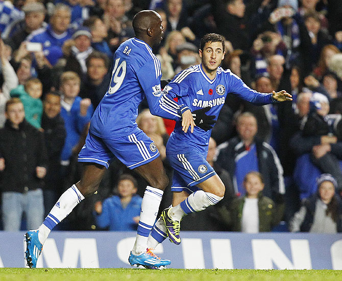 Eden Hazard of Chelsea celebrates with teammate Demba Ba after scoring the equaliser against West Bromwich Albion during their Barclays Premier League match at Stamford Bridge on Saturday