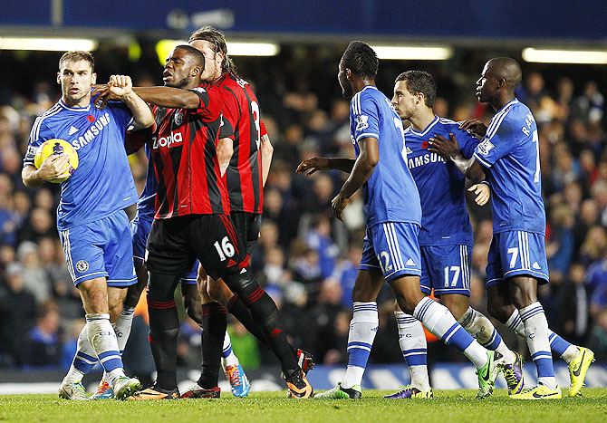 Branislav Ivanovic of Chelsea and West Brom's Victor Anichebe square up after Chelsea score the late equaliser during their Barclays Premier League match at Stamford Bridge on Saturday