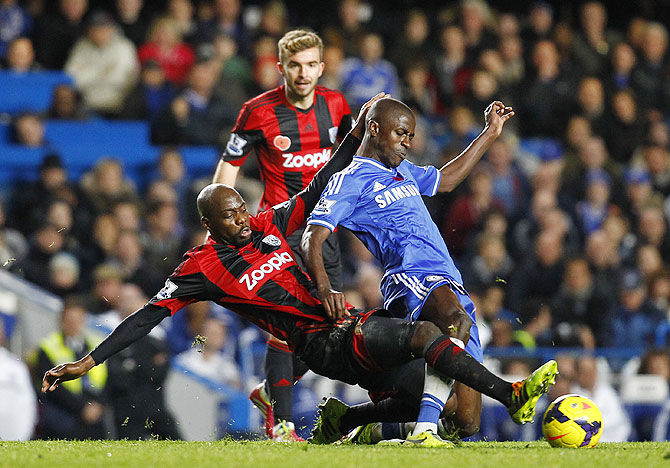 Youssof Mulumbu of West Brom and Chelsea's Ramires fight for possession during their Barclays Premier League match at Stamford Bridge on Saturday