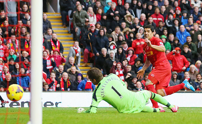 Luis Suarez of Liverpool scores the third goal during their Premier League match against Fulham at Anfield on Saturday