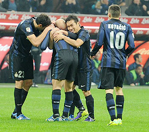 Yuto Nagatomo of FC Inter Milan (centre) celebrates scoring the second goal during the Serie A match against AS Livorno Calcio at San Siro Stadium in Milan on Saturday