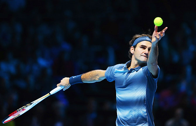 Roger Federer of Switzerland serves during his men's singles semi-final match against Rafael Nadal of Spain during their ATP World Tour Finals at O2 Arena in London on Sunday