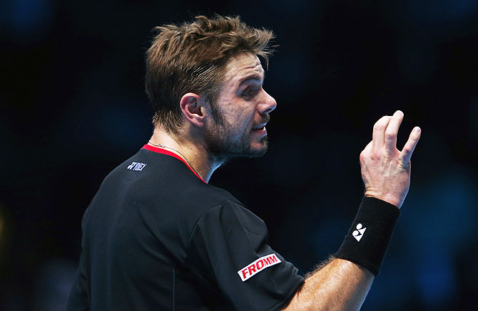 Stanislas Wawrinka of Switzerland gestures in his men's singles semi-final match against Novak Djokovic of Serbia during their ATP World Tour Finals at O2 Arena in London on Sunday