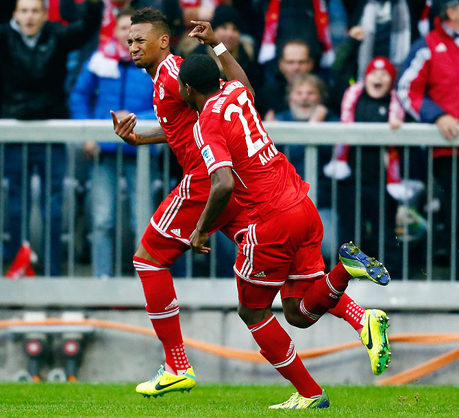 Bayern Munich's Jerome Boateng celebrates with David Alaba (right) after scoring against FC Augsburg during their Bundesliga match in Munich on Saturday