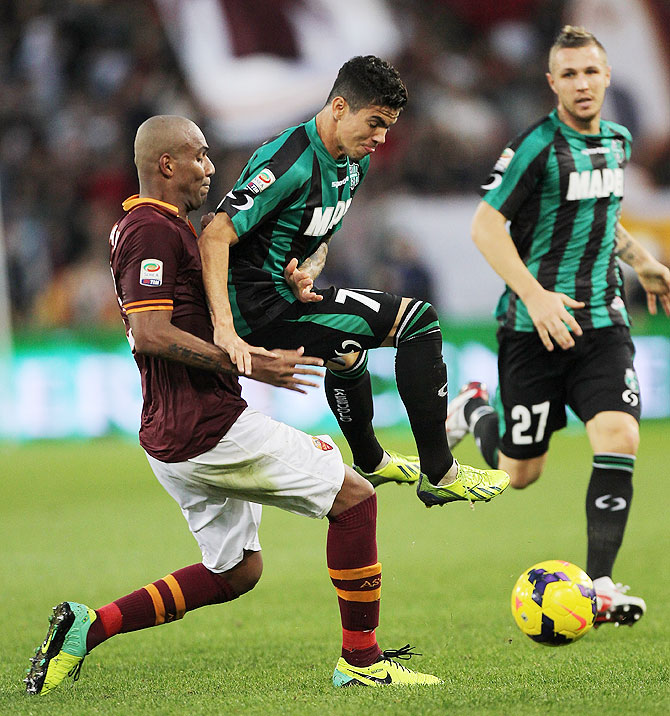 Farias of US Sassuolo Calcio competes for the ball with Maicon (left) of AS Roma during their Serie A match at Stadio Olimpico in Rome on Sunday