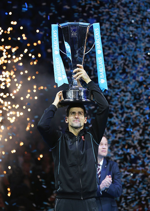 Novak Djokovic of Serbia lifts the trophy after beating Rafael Nadal of Spain to win the final of the ATP World Tour Finals at O2 Arena in London on Monday