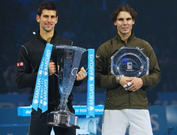 Champion Novak Djokovic (L) of Serbia and Rafael Nadal of Spain pose with their trophies after their men's singles final
