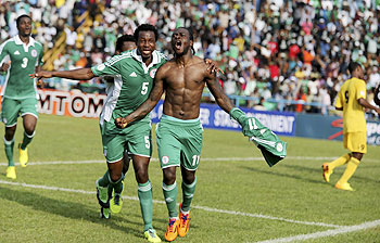 Victor Moses of Nigeria (right) celebrates after scoring a goal against Ethiopia during their 2014 World Cup qualifying playoff match at U.J Esuene stadium in Calabar on Saturday