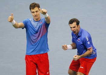Tomas Berdych (left) and Radek Stepanek of Czech Republic celebrate victory in their men's doubles match