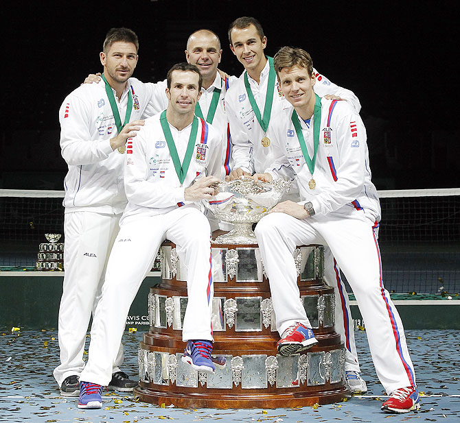 Tomas Berdych, Radek Stepanek team captain Vladimir Safarik, Lukas Rosol and Jan Hayek of Czech Republic hold the winners trophy aloft after a 3-2 victory against Serbia during day three of the Davis Cup World Group Final between Serbia and Czech Republic at Kombank Arena in Belgrade, Serbia, on Sunday