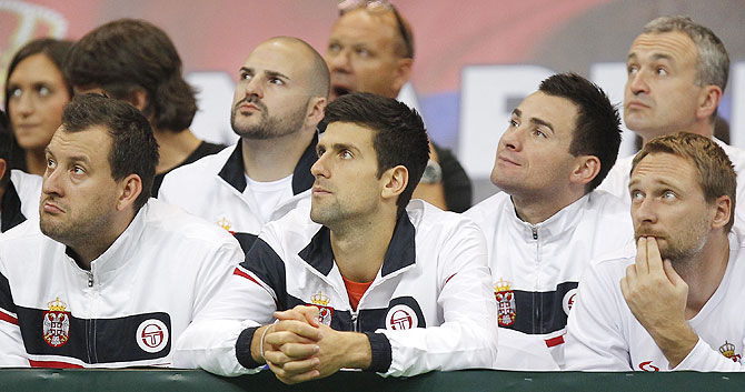 Novak Djokovic (centre) watches the men's singles match between Dusan Lajovic of Serbia and Radek Stepanek of Czech Republic on day three of the Davis Cup World Group Final between Serbia and Czech Republic at Kombank Arena in Belgrade, Serbia, on Sunday