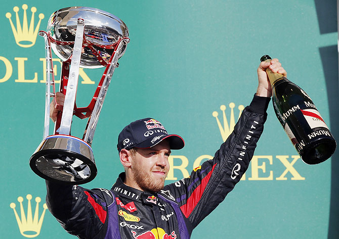 Red Bull Formula One driver Sebastian Vettel of Germany celebrates with his trophy on the podium after winning the Austin F1 Grand Prix at the Circuit of the Americas in Austin, Texas