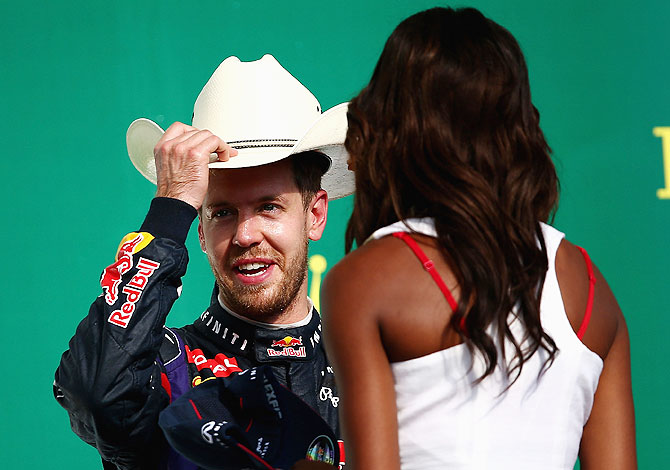 Sebastian Vettel of Germany and Red Bull Racing celebrates on the podium after winning the United States Formula One Grand Prix at Circuit of The Americas in Austin, Texas on Sunday