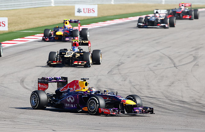 Sebastian Vettel of Germany and Red Bull Racing leads Romain Grosjean of France and Lotus and teammate Mark Webber of Australia during the United States Formula One Grand Prix at Circuit of The Americas in Austin, Texas on Sunday