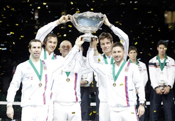 (L-R) Radek Stepanek, Lukas Rosol (team captain), Vladimir Safarik, Tomas Berdych and Jan Hayek of Czech Republic hold the winners trophy aloft after a 3-2 victory against Serbia